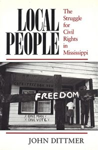 Cover of Dittmer's Local People, with image of Black people going into a building with one man, one vote written on the wall, with a sign reading freedom in the foreground
